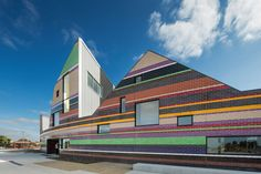 Unique learning spaces in a very colorful façade.