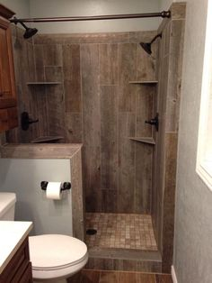 A must have in my farmhouse! Need this wood tile shower :) 28 Rustic Bathroom Ideas Making Impact to Atmosphere Small Rustic Bathrooms, Beautiful Small Bathrooms, Amazing Bathrooms, Tiny Bathrooms, Primitive Bathrooms, Narrow Bathroom, Small Cabin Bathroom, Brown Bathroom, Rustic Master Bathroom
