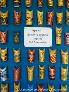 Egyptian Cat Mummies out of toilet paper rolls and masking tape. (What could we put inside to make it more interesting?)