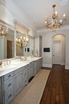 Love this bathroom - double sink & rustic cabinets but NOT that chandelier & lamps.