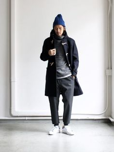 For an everyday outfit that is full of character and personality wear a black duffle coat and charcoal sweatpants. Complement this look with white low top sneakers.  Shop this look for $153:  http://lookastic.com/men/looks/beanie-hoodie-duffle-coat-crew-neck-t-shirt-sweatpants-low-top-sneakers/6823  — Navy Beanie  — Grey Hoodie  — Black Duffle Coat  — White Crew-neck T-shirt  — Charcoal Sweatpants  — White Low Top Sneakers