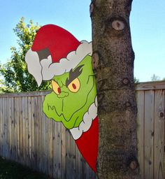 Grinch yard art grinch tree peeker.handmade by DoorHangersByRainy