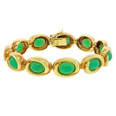 Tiffany & Co. Chrysoprase Bracelet. Circa 1980s, 18k, Tiffany and Co., New York. Set with vibrant green chrysoprase cabochons, this 18k yellow gold Tiffany bracelet is colorful and stylish. The look is everyday chic. Superbly fashioned, it is classic everyday Tiffany.