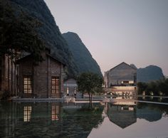 Vector Architects has transformed a disused sugar mill in China's mountainous Yangshuo County into a resort hotel featuring a group of gabled masonry structures designed to complement the existing industrial architecture.