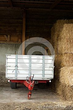 Photo about This is an image of a metal wagon trailer parked next to a pile of large hay bales in a Swiss farm. Image of large, image, bales - 71912568 Hay Barn, Permaculture, Stock Photos, Park, Metal, Image, Parks, Metals