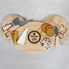 Oval cheese board with integrated specialty knife compartment. Made from sustainable and environmentally friendly Hevea wood. Includes 4 wooden handled specialist stainless steel cheese knives in rotating knife compartment: Cheese Fork, Stilton Knife, Cheddar Knife, Parmesan Knife. Personalise with name and date. The words 'Original & Handmade' and 'Artisan Producer' come as standard. Important Note: Name will appear exactly as entered including apostrophes e.g. If the customer requires ...