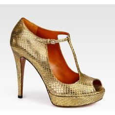 The Betty Metallic Python Peep-Toe sandals.
