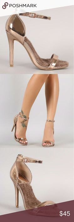 """Rose Gold Metallic Open Toe Patent Stiletto Heel DESCRIPTION This stunning heel features an open toe silhouette, wrapped stiletto heel, and adjustable ankle strap with buckle fastening. Finished with a soft faux fur insole for comfort.  Material: Vegan Patent Leather (man-made) Sole: Synthetic Color: ROSE GOLD METALLIC  MEASUREMENT Heel Height: 4.25"""" (approx)  TRUE SIZE SARAH SIAH  Shoes Heels"""