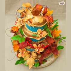 Click here to view our Autumn Wedding Cake by Odry Cakes: http://cakejournal.com/fondant-friday/autumn-wedding-cake/