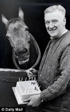 Red Rum ready to enjoy his birthday cake from trainer Ginger McCain....He looks like he is having a laugh!