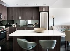 Glamour and Grain: Exotic wood grains add texture and glamour to a kitchen