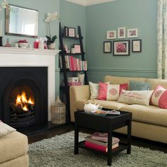 colors of the living room: robin's egg blue, white trim, cream and brown furniture with black accents (I LOVE THIS ROOM!)