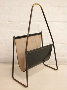 Magazine rack by Carl Aubock.
