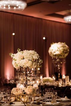 Elevated centerpieces with white flowers propped onto silver crystal candelabra - Luxury Winter Wedding at the Four Seasons by Flora Nova Design Seattle Ballroom Wedding Reception, Wedding Reception Flowers, Winter Wedding Flowers, Floral Wedding, White Centerpiece, Tall Wedding Centerpieces, Wedding Flower Arrangements, Floral Centerpieces, Winter Wedding Ceremonies