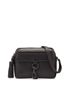 "Rebecca Minkoff pebbled calfskin camera bag. Tonal hardware. Adjustable shoulder strap, 24.5"" drop. Zip top closure. Decorative spring-lock front. Interior, jacquard lining; one slip pocket. 5.5""H x 7"