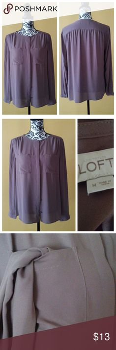 LOFT shirt Business Casual LOFT shirt. 2 functional pockets, and button closure on sleeve. Semi sheer shirt. Gently pre-owned condition. LOFT Tops Button Down Shirts