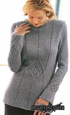 Пуловер с аранами в виде древнего знака-талисмана.