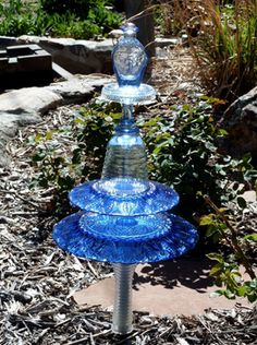 How to Make Glass Totems for Your Garden - using thrifted glass and glue - via Shelley Michel at Mia's Garden