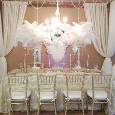 l i g h t i n g & c r y s t a l s #gatsby #gatsbytheme #feathers #classy…