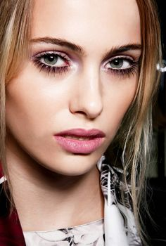 A touch of shimmery lavender eyeshadow gives these falsies eyelashes a soft look. Top it off with a petal pink lipstick