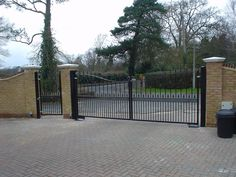 Steel swing gate with pedestrian gate. Visit http://frontline-auto.com