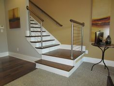 Our cable railing systems give your stairs a distinct modern touch. Expertly installed, they lend a unique beauty to your stairs. Stair Railing, Stairs, Cable Railing Systems, Newel Posts, Wood And Metal, Contemporary, Modern, Interior And Exterior, Southern
