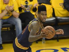 Cleveland Cavaliers guard Iman Shumpert (4) moves the ball up court against the Golden State Warriors during the first half in game one of the NBA Finals at Oracle Arena.  Bob Donnan, USA TODAY Sports