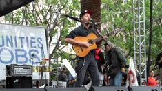 """Tom Morello (Rage Against The Machine, Nightwatchman) performs his anthem """"Union Song"""" in support of union workers nationwide at a protest rally in downtown LA. Tom Morello, Protest Songs, Rage Against The Machine, Toms, Music, Musica, Musik, Muziek, Music Activities"""