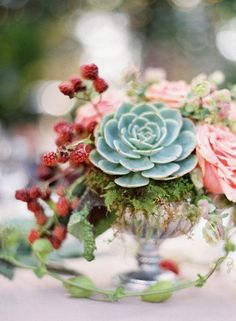 florals and succulents in glass