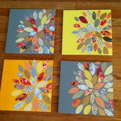 Painted canvas with scrapbook paper petals. Do with the four corners as center and petals fanning out?