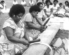 """Women are here seen in various stages of beating bark into cloth, """"masi"""", for use mainly in ceremonial presentations, though some will be used for decoration and for personal use."""
