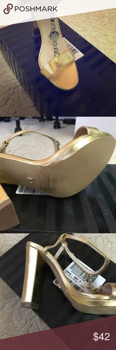 BNIB Victoria Secret Gold Metallic Sandals Brand new, never worn. Comes with original box, papers and dust bag. Purchased from the New York VS store. Very hot shoe, chunky heel. Chain design with angel wing medallion. Victoria's Secret Shoes Heels