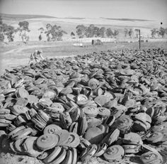 Huge dump of German Teller mines captured by the US Seventh Army near Roccopalunba, Sicily during their drive on Palermo, July 1943. - See more at: http://ww2today.com/#sthash.ziRwpYUF.dpuf