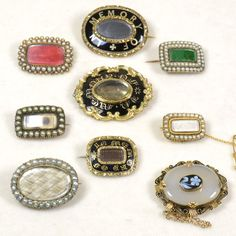 Group of Antique 19th Century mourning Brooches: some with hair, enamel and seed pearls.