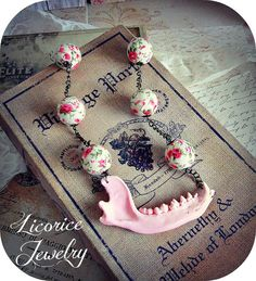 Delicate PINK Raccoon Jaw Bone Replica Floral Beaded Necklace by LicoriceJewelry on Etsy