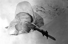 """Allegedly a photograph of Simo Häyhä, a Finnish Sniper nicknamed """"White Death"""" by the Russians, taking aim down the sights of a Mosin-Nagant M/28. Häyhä is a credited with the highest recorded number of confirmed sniper kills, 505, all within a period of only 100 days during The Winter War between Finland and Russia in '39/'40."""
