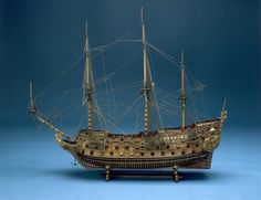 Object ID SLR0001 Description Scale: 1:48. Navy Board skeleton model thought to be the 'Naseby' (1655), an 80-86 gun ship, three-decker ship of the line. The hull shape is typical of that of a 17th century warship with a fair amount of sheer and tumblehome. The model is partly decked, rigged and made plank on frame in the Navy Board style. The hull is unplanked below the waterline, and the framing system is typical of that of the Navy Board style, with floor timbers spanning the keel…