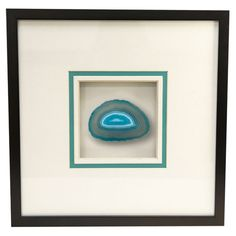 Add a natural touch to your entryway or master suite with this organic-chic wall decor, featuring a slice of agate displayed under glass and highlighted by a...