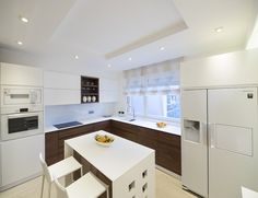 Cozy and modern kitchen. Walnut veneered MDF, painted MDF, Kerrock...