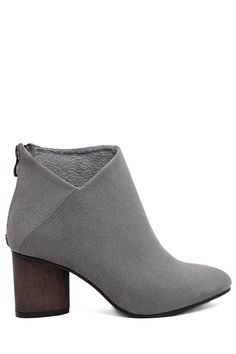 gorgeous ankle boot. love the soft grey suede, chunky wood grain heel, and unique v-shape cut at the ankle. these would look great with anything. gotta have 'em!