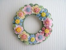 Another beautiful creation from this blogger: gorgeous felt embroidered flower wreath.
