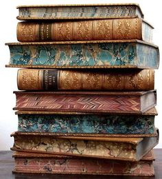 old books with marbled edge paper