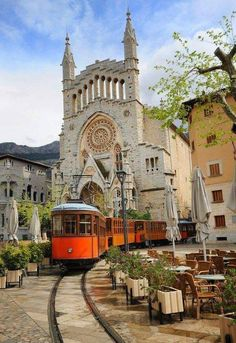 Photo about Old tram in the downtown of Soller in front of medieval gothic cathedral with huge rose window, Mallorca, Spain. Image of mallorca, rail, soler - 63253688 Places Around The World, Travel Around The World, Places To Travel, Places To See, Places In Spain, Voyage Europe, Spain And Portugal, Lisbon Portugal, Spain Travel