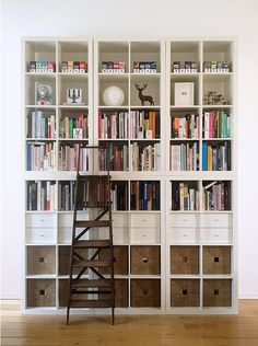 Decoaring the bookshelves to have different horizontal sections might be a good strategy in the dining room.