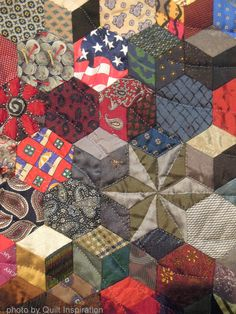 close up, Universal Ties by Nancy Ota (San Clemente, California, USA).   English paper pieced tumbling blocks quilt made with silk ties.  Photo by Quilt Inspiration