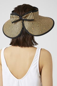 05805a445de Roll-up cut-out paper straw hat with black zig-zag pattern