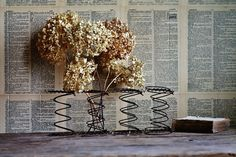 Antique Market Basket, Egg Basket, Milk Strainer Light, Flower Frogs, Tarnished Trays, Treadle Sewing Machine Wheel and Rusty Springs via http://knickoftimeinteriors.blogspot.com
