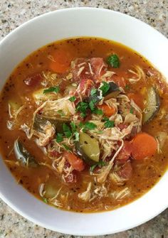 Top 10 Best Vegetable Soups picture shown is Italian chicken vegetable soup delish