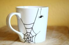 Halloween Hand Painted Ceramic Mug Tea Cup With Spider and spired webs Minimalist modern white coffee cup  Decorative Ceramic Art. $23.00, via Etsy.