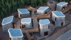 Studio Avoid has completed a retreat in China's Hebei province comprising a series of cave-like brick-clad pods connected by a raised walkway. Brick Facade, Brick Wall, Nendo Design, Bamboo Ceiling, Wooden Walkways, Community Housing, Getaway Cabins, Chinese Architecture, Outdoor Furniture Sets